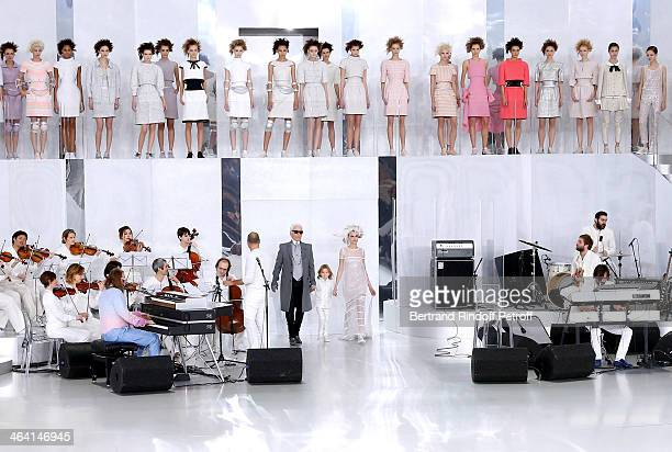 Fashion designer Karl Lagerfeld his godson Hudson Kroenig and Model Cara Delevingne walk the runway at the end of the Chanel show as part of Paris...