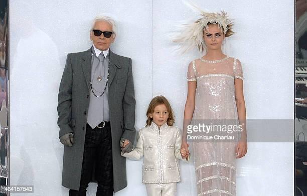 Fashion designer Karl Lagerfeld his godson Hudson Kroenig and model Cara Delevingne walk the runway during the Chanel show as part of Paris Fashion...