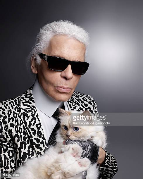 Fashion designer Karl Lagerfeld is photographed with his cat Choupette for Madame Figaro on November 18 2015 in Paris France COVER IMAGE CREDIT MUST...