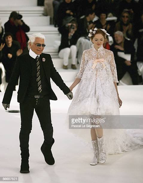 Fashion designer Karl Lagerfeld is seen on the catwalk with one of his model during the Chanel Fashion show at the Grand Palais on January 24 2006 in...