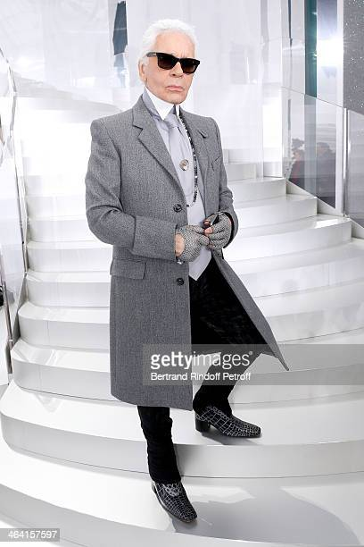 Fashion designer Karl Lagerfeld poses backstage after the Chanel show as part of Paris Fashion Week Haute Couture Spring/Summer 2014 on January 21...