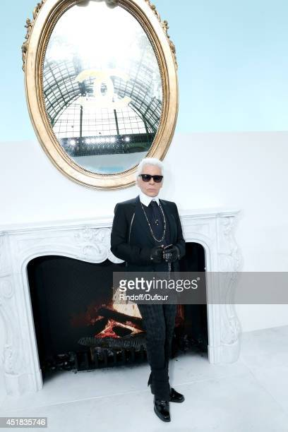 Fashion designer Karl Lagerfeld poses backstage at the Chanel show as part of Paris Fashion Week Haute Couture Fall/Winter 20142015 Held at Grand...