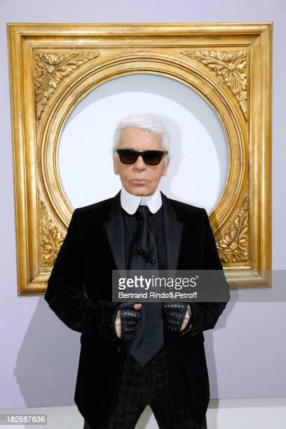 Fashion designer Karl Lagerfeld poses in front of his works before the Chanel show as part of the Paris Fashion Week Womenswear Spring/Summer 2014,...
