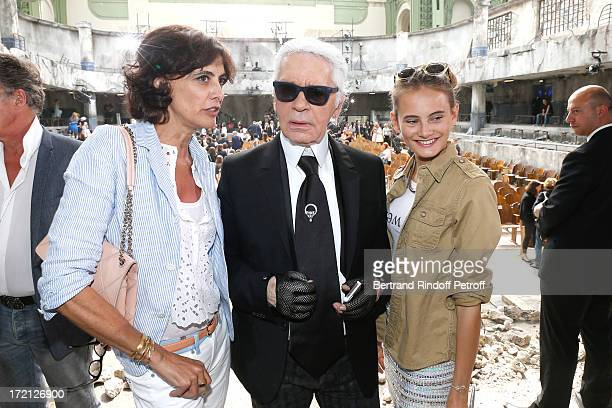Fashion Designer Karl Lagerfeld standing between Ines de La Fressange and her daughter Violette d'Urso attend the Chanel show as part of Paris...