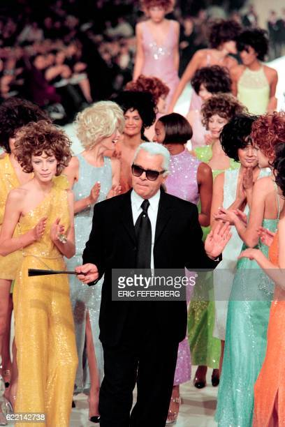 Fashion designer Karl Lagerfeld surrounded by top models Claudia Schiffer Helena Christensen and Naomi Campbell aknowledges teh audience after the...
