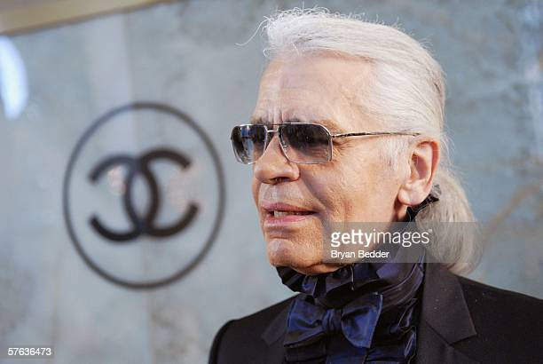 Fashion Designer Karl Lagerfeld talks with reporters at the Chanel 2006/2007 Cruise Collection fashion show May 17 2006 in New York City