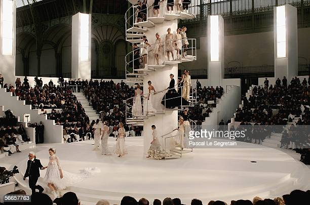 Fashion designer Karl Lagerfeld walks on the runway during the Chanel Fashion show at the Grand Palais on January 24 2006 in Paris France