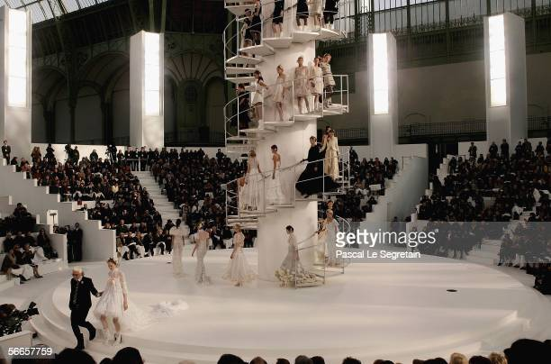 Fashion designer Karl Lagerfeld walks out of the runway during the Chanel Fashion show at the Grand Palais on January 24 2006 in Paris France