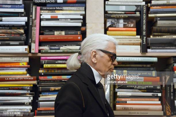 Fashion designer Karl Lagerfeld walks through an exhibition he coconceived at the Folkwang Museum in Essen Germany 14 February 2014 The exhibition...