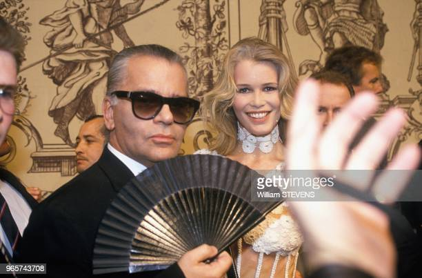 Fashion Designer Karl Lagerfeld With Fan And Claudia Schgiffer At Chanel Show Paris January 26 1993