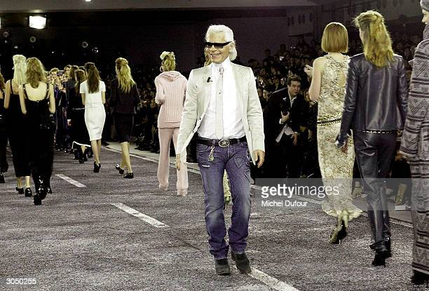 Fashion designer Karl Lagerfeld with models on the catwalk Chanel readytowear FallWinter 20042005 fashion collection March 5 2004 in Paris France