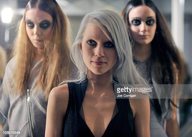 Fashion designer Katie Gallagher joins her models while their posing at the Katie Gallagher Fall 2011 fashion show during MercedesBenz Fashion Week...