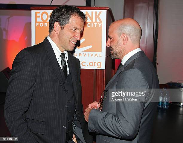 Fashion designer Kenneth Cole and actor Stanley Tucci talk at the Food Bank for New York City's 6th Annual CanDo Awards Dinner on April 21 2009 in...