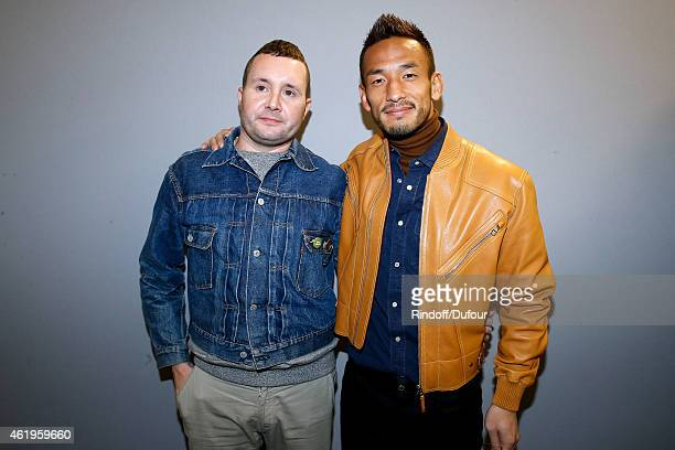 Fashion designer Kim Jones and Football Player Hidetoshi Nakata pose backstage after the Louis Vuitton Menswear Fall/Winter 20152016 Show as part of...