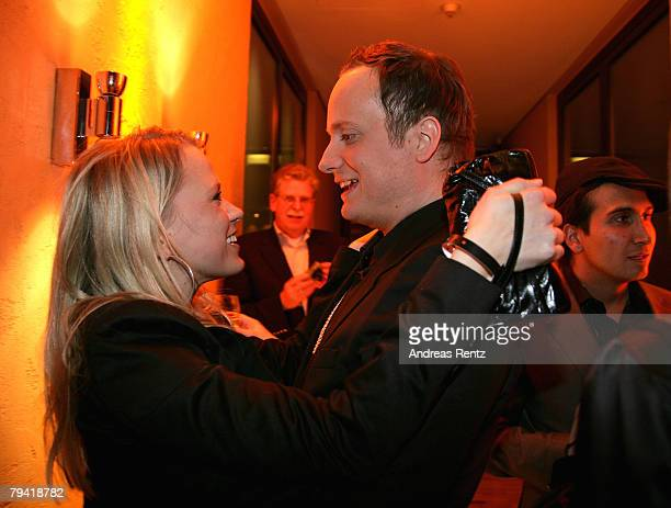 Fashion designer Klaus Unrath and Nova Meierhenrich attend the after show party to the Unrath Strano fashion show during the MercedesBenz Fashionweek...