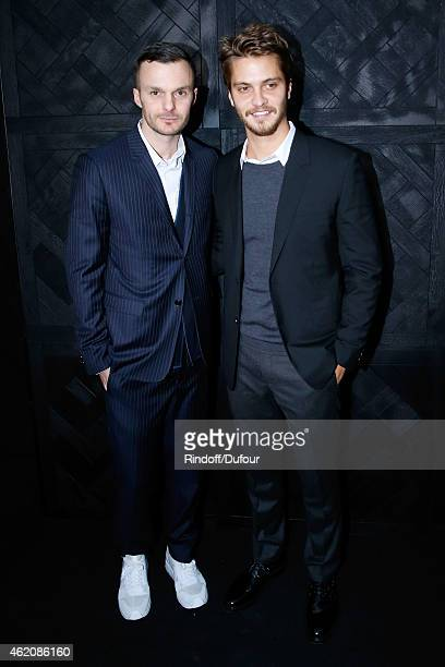 Fashion designer Kris Van Assche and Actor of movie 'Fifty shades of grey' Luke Grimes pose backstage after the Dior Homme Menswear Fall/Winter...