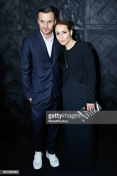 Fashion designer Kris Van Assche and actress Noomi Rapace pose backstage after the Dior Homme Menswear Fall/Winter 20152016 Show as part of Paris...