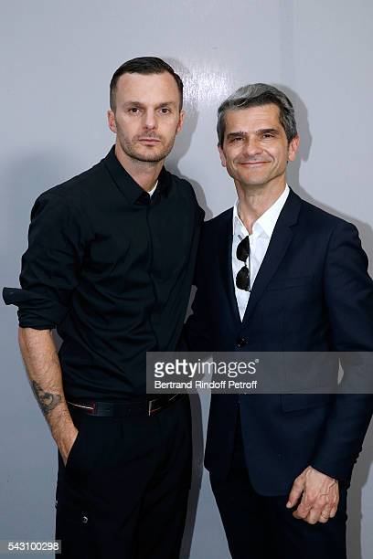Fashion designer Kris Van Assche and Chief operating officer of Christian Dior Couture Serge Brunschwig pose Backstage after the Dior Homme Menswear...