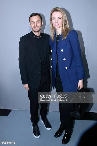 Fashion designer Kris Van Assche and Louis Vuitton's executive vice president Delphine Arnault pose Backstage after the Dior Homme Menswear...