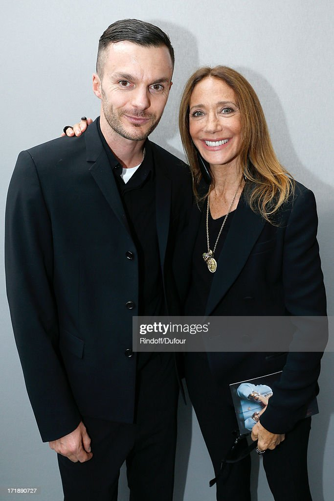 Fashion designer Kris Van Assche and Marisa Berenson backstage after Dior Homme Menswear Spring/Summer 2014 Show as part of the Paris Fashion Week on June 29, 2013 in Paris, France.