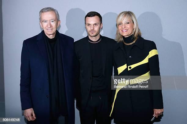 Fashion designer Kris Van Assche pose Backstage between Owner of LVMH Luxury Group Bernard Arnault and his wife Helene Arnault after the Dior Homme...