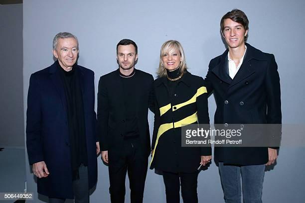 Fashion designer Kris Van Assche pose Backstage between Owner of LVMH Luxury Group Bernard Arnault his wife Helene Arnault and their son Alexandre...