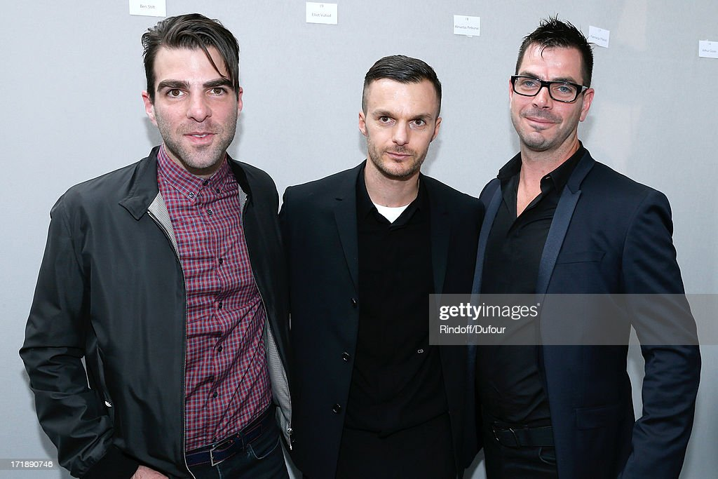 Fashion designer Kris Van Assche standing between actor Zachary Quinto and his brother Joe Quinto backstage after Dior Homme Menswear Spring/Summer 2014 Show as part of the Paris Fashion Week on June 29, 2013 in Paris, France.