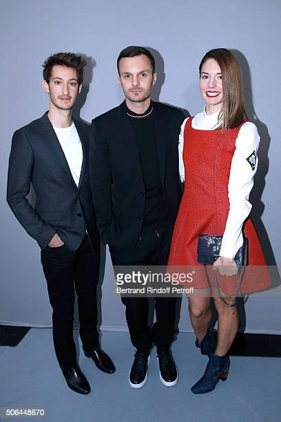 Fashion designer Kris Van Assche standing between Actors Pierre Niney and Natasha Andrews pose Backstage after the Dior Homme Menswear Fall/Winter...