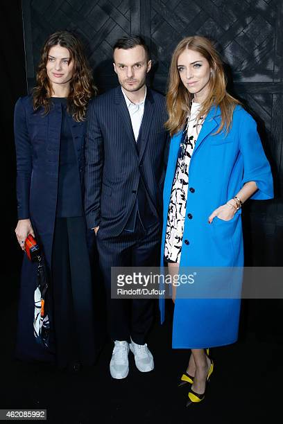 Fashion designer Kris Van Assche standing between Models Chiara Ferragni and Isabeli Fontana pose backstage after the Dior Homme Menswear Fall/Winter...