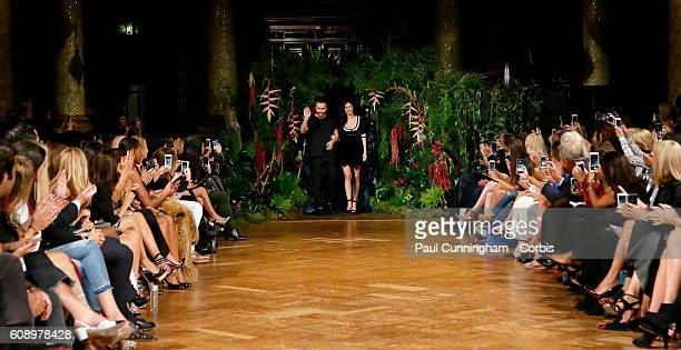 Fashion designer Kristian Aadnevik and wife Hila take a bow to the audience at the end of the collection during the Kristian Aadnevik show during...