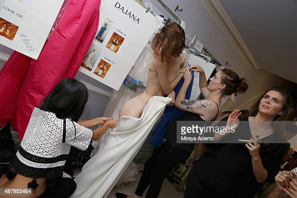 Fashion designer Laura Kim prepares a model backstage before the Monse fashion show during Spring 2016 MADE Fashion Week at Norwood Club on September...