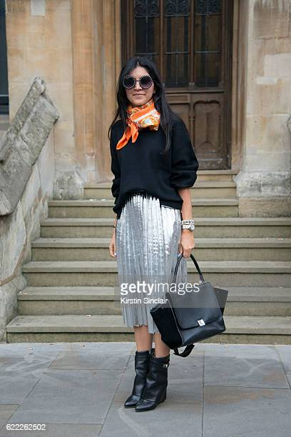 Fashion designer Leila Maleki wears a vintage scarf Zara sweater and skirt Givenchy shoes and Celine bag day 4 of London Womens Fashion Week...