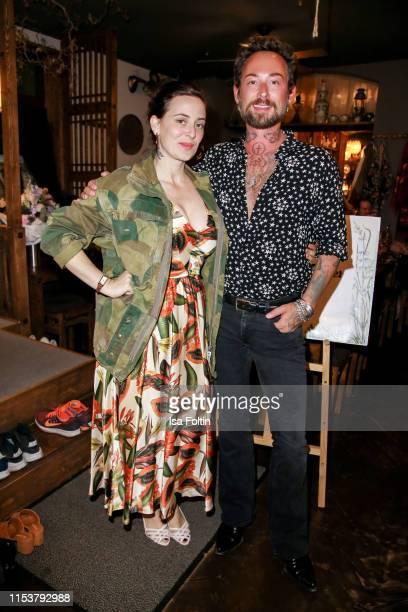 Fashion designer Lena Hoschek and fashion designer Marcel Ostertag during the Umami after show dinner on July 4 2019 in Berlin Germany