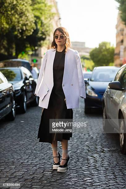 Fashion designer Lilia Litkovskaya wears her own design Litkovskaya and Prada shoes on June 24 2015 in Paris France