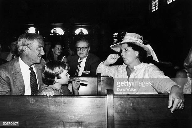 Fashion designer Lillly Pulitzer w first husband Herbert Pulitzer Jr second husband Enrique Rousseau and unident child at christening of Lilly's...