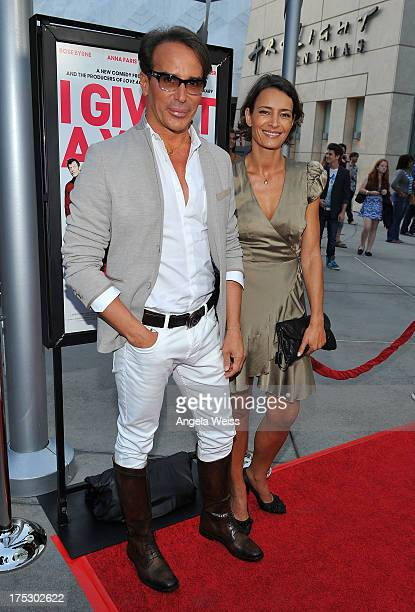 Fashion designer Lloyd Klein and actress Bahia Haifi arrive at the Screening of Magnolia Pictures' 'I Give It A Year' at ArcLight Hollywood on August...