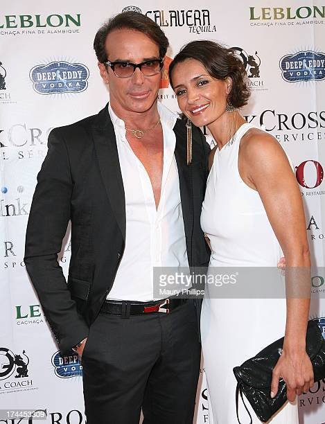 Fashion Designer Lloyd Klein and Bahia Haifi arrives at the 40th Anniversary StockCross Party on July 25 2013 in Beverly Hills California