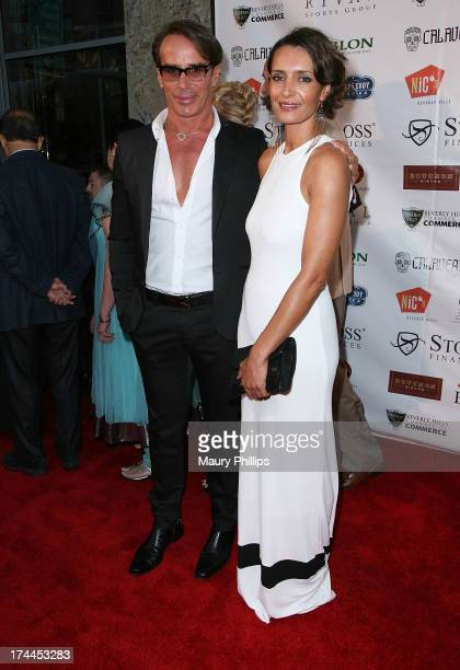 Fashion Designer Lloyd Klein and Bahia Haifi attend the 40th Anniversary StockCross Party on July 25 2013 in Beverly Hills California