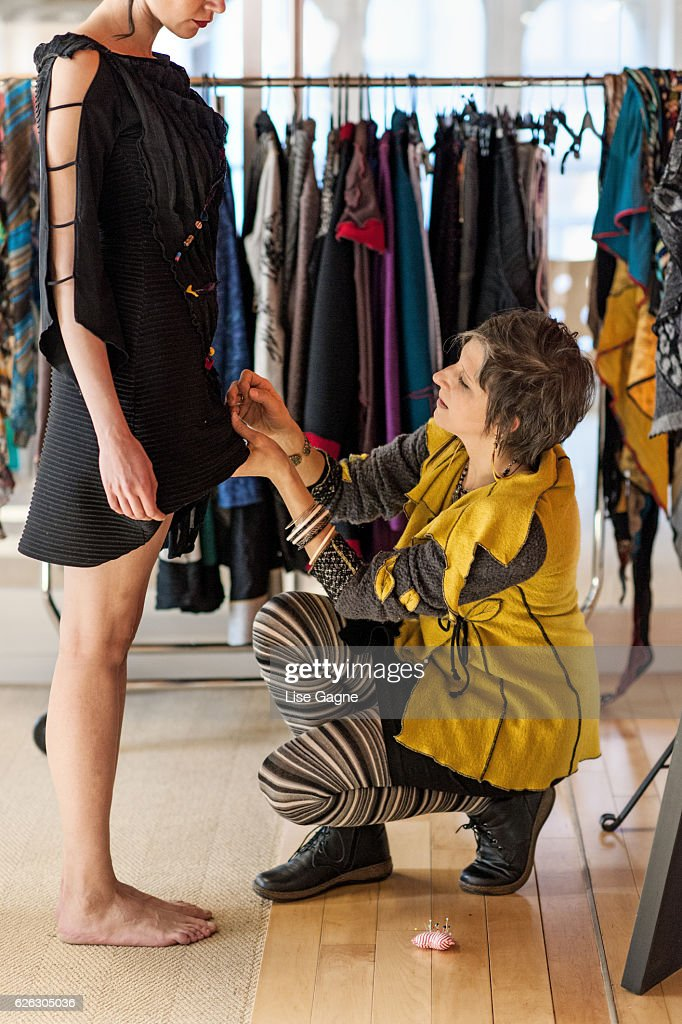Fashion Designer making adjustment : Stock Photo