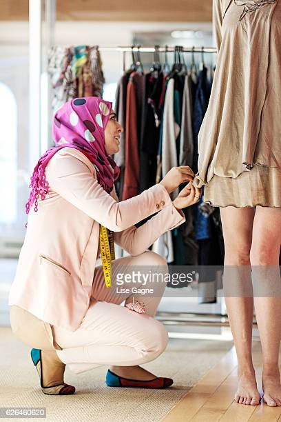 Fashion Designer making adjustment
