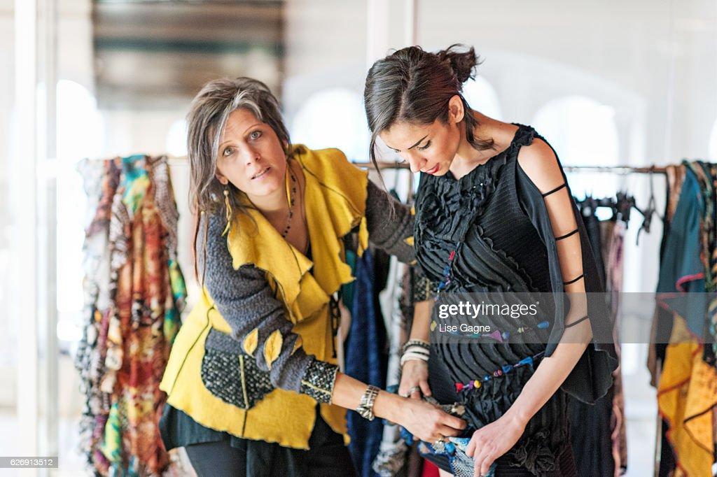 Fashion Designer making adjustment : Stock Photo