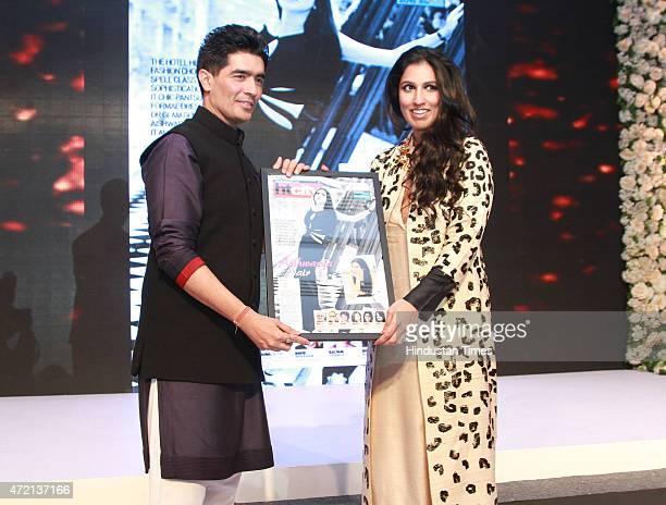 Fashion designer Manish Malhotra presenting the most stylish award to Aishwarya Nair director Leela Group of Hotels at the Hindustan Times Delhis...