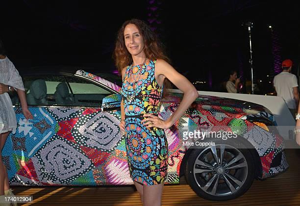 Fashion designer Mara Hoffman poses in front of the 2014 MercedesBenz E350 Cabriolet by Mara Hoffman at MercedesBenz Fashion Week Swim 2014 Official...
