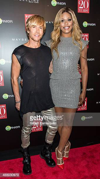 Fashion designer Marc Bouwer and Laverne Cox attend the Instyle 20th Anniversary Party at Diamond Horseshoe at the Paramount Hotel on September 8...