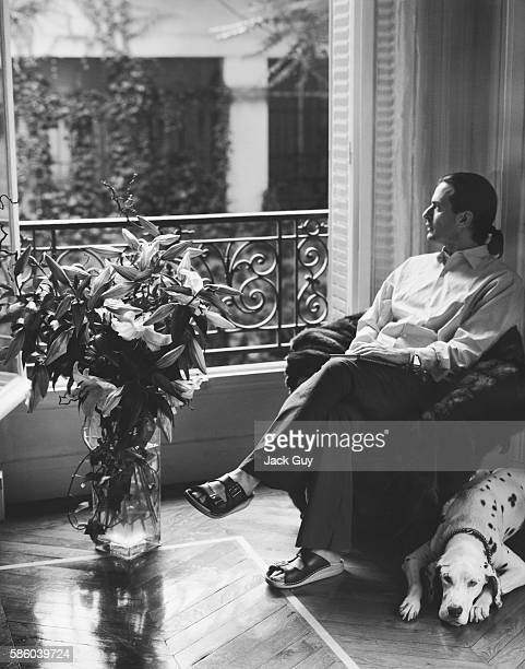 Fashion designer Marc Jacobs is photographed for InStyle Magazine with his dog relaxing at home in New York City