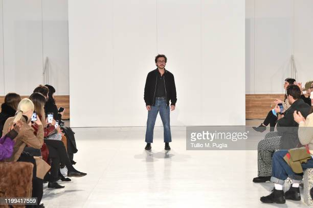 Fashion designer Marco De Vincenzo acknowledges the applause of the audience at the Marco De Vincenzo fashion show on January 14 2020 in Milan Italy