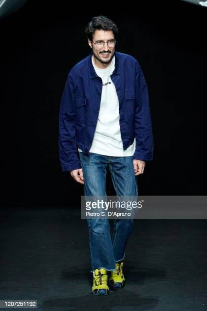 Fashion designer Marco Rambaldi acknowledges the applause of the audience during the Marco Rambaldi fashion show as part of Milan Fashion Week...