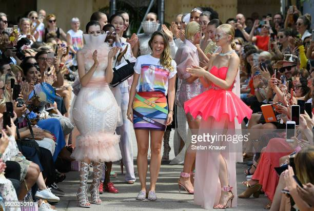 Fashion designer Marina Hoermanseder is applauded by models after her show during the Berlin Fashion Week Spring/Summer 2019 at ewerk on July 5, 2018...