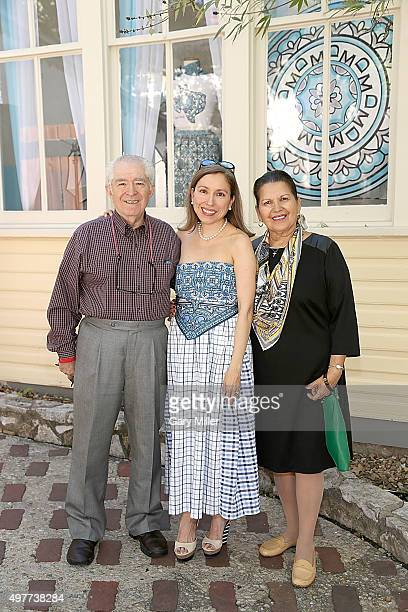 Fashion designer Marisol Deluna and her parents pose outside her new store as Marisol Deluna New York Celebrates the Grand Opening Of Design Studio...
