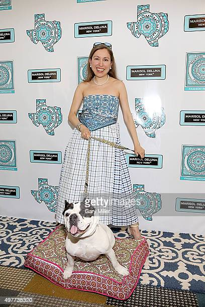 Fashion designer Marisol Deluna and Rubble the dog pose on the red carpet as Marisol Deluna New York Celebrates the Grand Opening Of Design Studio...